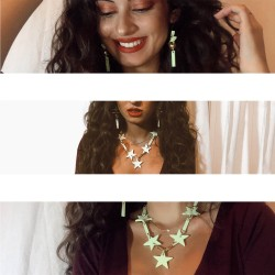 Stephie Loren posing with the Light green stars necklaces of San Fabrizzio
