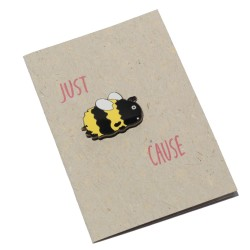 """""""Just Bee Cause"""" bee enamel pin with a card made of Bee Saving Paper"""
