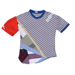 T-shirt made entirely in patchwork of different fabrics of end-of-stock fabrics, upcycled or recycled fabrics, and embroideries.